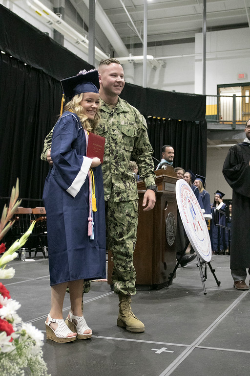 . North Middlesex Regional High School graduation was held on Friday night at Fitchburg State University Recreation Center. Graduate Madison Davis was shocked when she heard that Navy Petty Officer Zachary Davis, a graduate of NMRHS in 2014, her brother was going to give her her diploma. He posed for a formal picture with her. SENTINEL & ENTERPRISE/JOHN LOVE