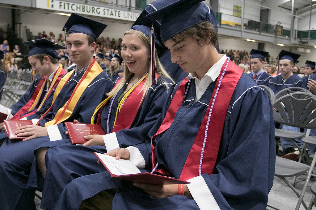 . North Middlesex Regional High School graduation was held on Friday night at Fitchburg State University Recreation Center. Graduate John O\'Friel looks at his diploma. SENTINEL & ENTERPRISE/JOHN LOVE