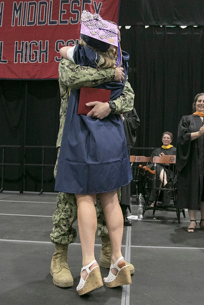 North Middlesex Regional High School graduation was held on Friday night at Fitchburg State University Recreation Center. Graduate Madison Davis was shocked when she heard that Navy Petty Officer Zachary Davis, a graduate of NMRHS in 2014, her brother was going to give her her diploma. SENTINEL & ENTERPRISE/JOHN LOVE