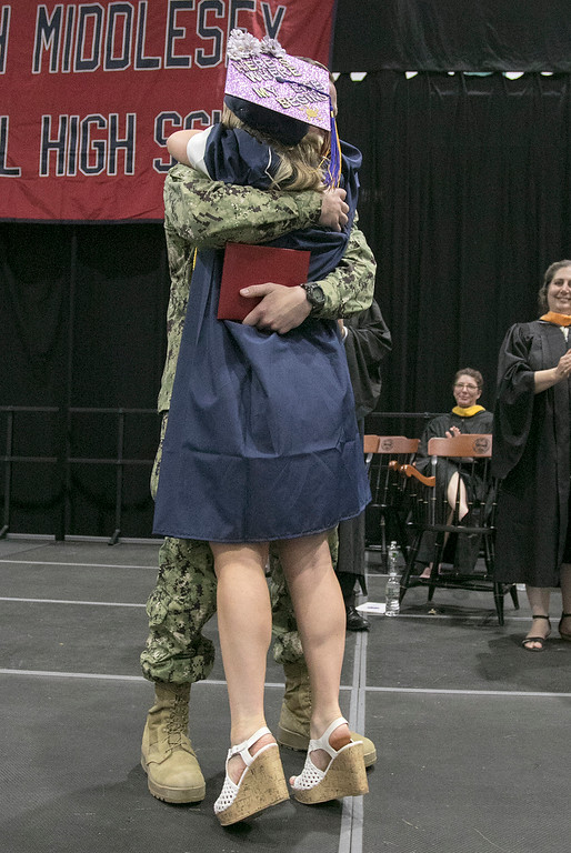 . North Middlesex Regional High School graduation was held on Friday night at Fitchburg State University Recreation Center. Graduate Madison Davis was shocked when she heard that Navy Petty Officer Zachary Davis, a graduate of NMRHS in 2014, her brother was going to give her her diploma. SENTINEL & ENTERPRISE/JOHN LOVE