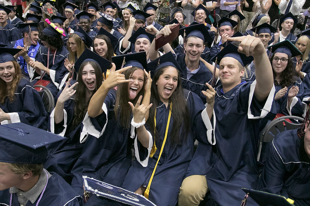 . North Middlesex Regional High School graduation was held on Friday night at Fitchburg State University Recreation Center. Graduate celebrate after they got their diplomas. SENTINEL & ENTERPRISE/JOHN LOVE