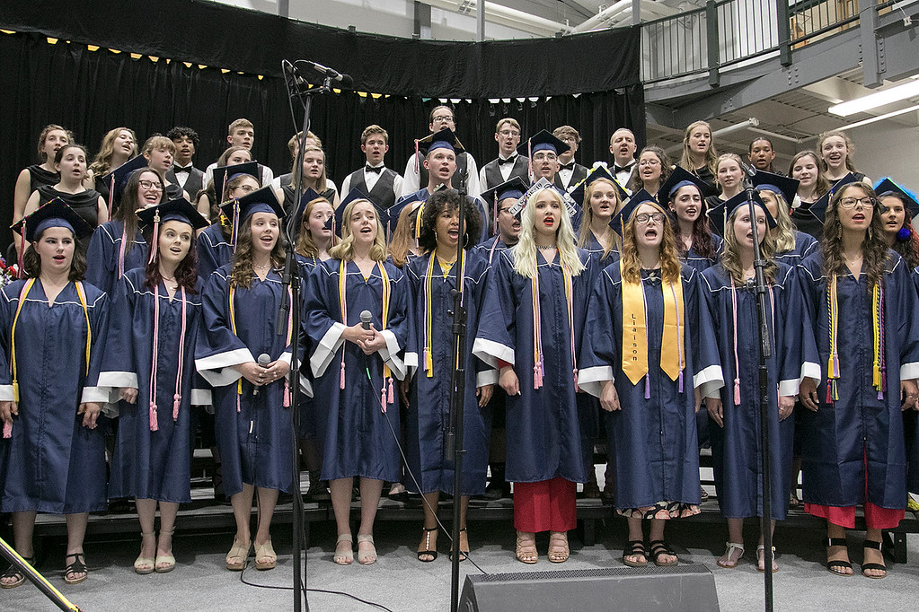 ". North Middlesex Regional High School graduation was held on Friday night at Fitchburg State University Recreation Center. Graduates sing with the NMRHS choirs as they poerform the song ""Rise Up\"" during the ceremony. SENTINEL & ENTERPRISE/JOHN LOVE"