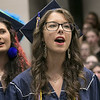 "North Middlesex Regional High School graduation was held on Friday night at Fitchburg State University Recreation Center. Graduate Jillian Hersey sings with the NMRHS choirs as they poerform the song ""Rise Up"" during the ceremony. SENTINEL & ENTERPRISE/JOHN LOVE"