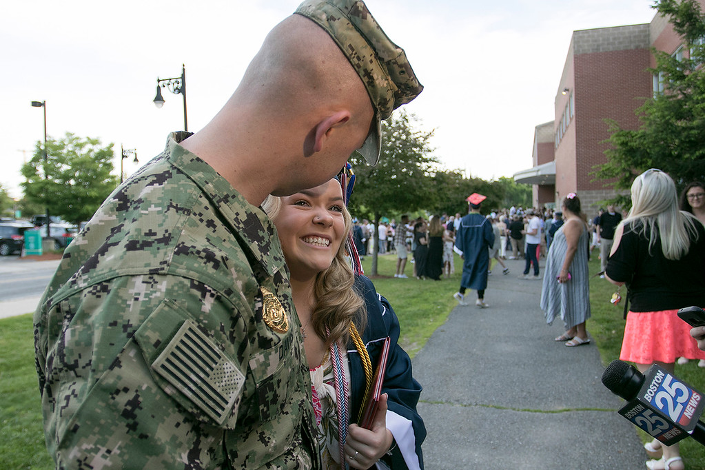 . North Middlesex Regional High School graduation was held on Friday night at Fitchburg State University Recreation Center. Graduate Madison Davis was shocked when she heard that Navy Petty Officer Zachary Davis, a graduate of NMRHS in 2014, her brother was going to give her her diploma. After the ceremony she still had a big smile in her face they the both of them talked to the media. SENTINEL & ENTERPRISE/JOHN LOVE