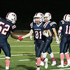 North Middlesex Regional High School football played Nashoba Regional High School Friday, Oct. 4, 2019 in Townsend. NRHS's #81 Dan McGrath, who came up with a fumble, is congratulated by NMRHS's #52 Jared woods. SENTINEL & ENTERPRISE/JOHN LOVE