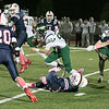 North Middlesex Regional High School football played Nashoba Regional High School Friday, Oct. 4, 2019 in Townsend. NMRHS #26 Pat Hazlett, on right, caused NRHS #22 Aiden Lee to fumble the ball. SENTINEL & ENTERPRISE/JOHN LOVE