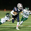 North Middlesex Regional High School football played Nashoba Regional High School Friday, Oct. 4, 2019 in Townsend. NRHS's #9 Joey Sabourin tackles NMRHS quarterback #12 Josh LeBlanc. NRHS's #33 Ethan Revell. SENTINEL & ENTERPRISE/JOHN LOVE