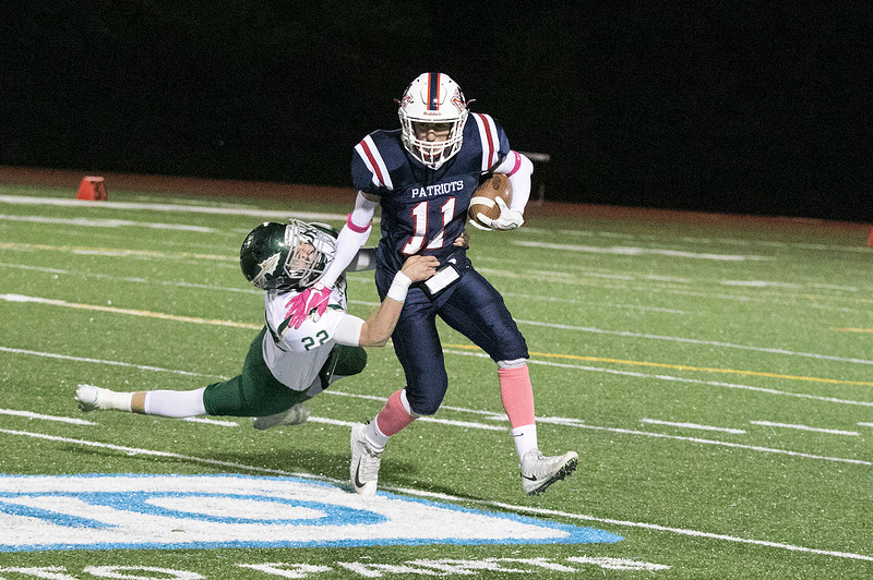 North Middlesex Regional High School football played Nashoba Regional High School Friday, Oct. 4, 2019 in Townsend. NRHS's #22 Aiden Lee and NMRHS's #11 Kyle Blaisdell. SENTINEL & ENTERPRISE/JOHN LOVE
