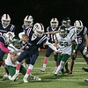 North Middlesex Regional High School football played Nashoba Regional High School Friday, Oct. 4, 2019 in Townsend. With ball NMRHS's quarterback #12 Josh LeBlanc and NRHS's #15 Trevor Schartner. SENTINEL & ENTERPRISE/JOHN LOVE