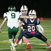 North Middlesex Regional High School football played Nashoba Regional High School Friday, Oct. 4, 2019 in Townsend. NMRHS's #20 Tim Burson looks to block NRHS's #9 Joey Sabourin to give NMRHS quarterback #12 Josh LeBlanc, right behind Burson, a hole to run through. SENTINEL & ENTERPRISE/JOHN LOVE