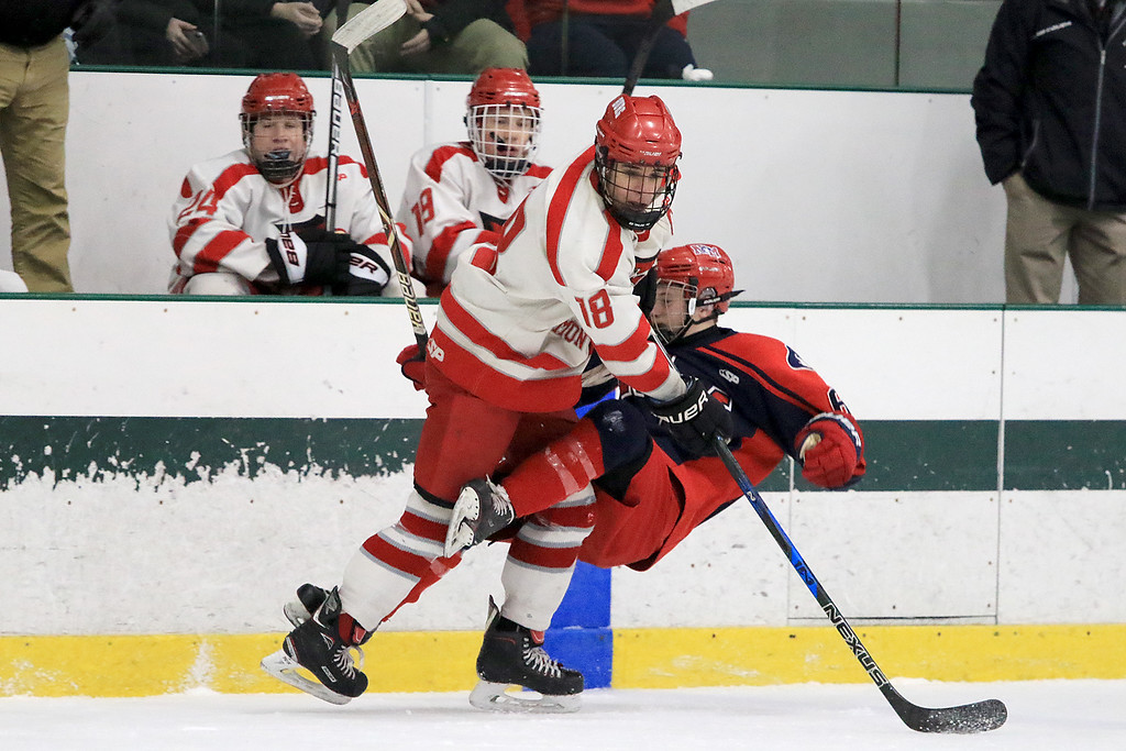 . North Middlesex Regional High School hockey played Fitchburg/Monty Tech High School on Tuesday afternoon at the Wallace Civic Center at Fitchburg State University.  Fitchburg\'s Anthony Lesperance checks NMRHS Ryan Lavery. SENTINEL & ENTERPRISE/JOHN LOVE