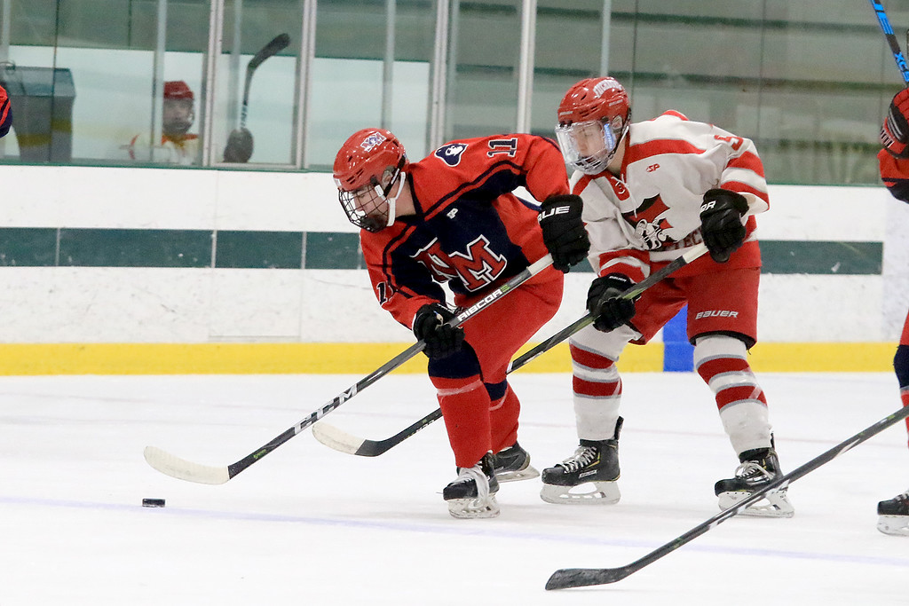 . North Middlesex Regional High School hockey played Fitchburg/Monty Tech High School on Tuesday afternoon at the Wallace Civic Center at Fitchburg State University. NMRHS\'s Michael Amari takes control of the puck. SENTINEL & ENTERPRISE/JOHN LOVE