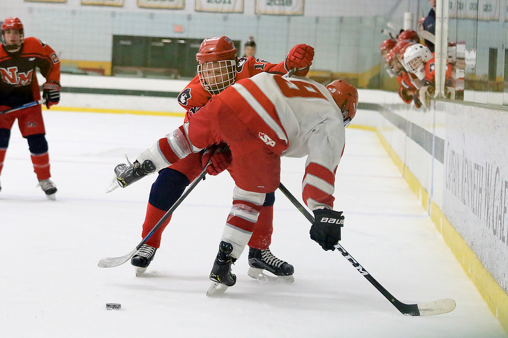 . North Middlesex Regional High School hockey played Fitchburg/Monty Tech High School on Tuesday afternoon at the Wallace Civic Center at Fitchburg State University. Fitchburg\'s Jake Thibeault tries to take the puck away from NMRHS\'s Trent Costa. SENTINEL & ENTERPRISE/JOHN LOVE