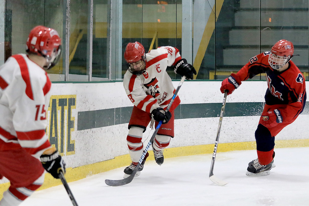 . North Middlesex Regional High School hockey played Fitchburg/Monty Tech High School on Tuesday afternoon at the Wallace Civic Center at Fitchburg State University. Taking control of the puck is Fitchburg\'s Anthony Lesperance. SENTINEL & ENTERPRISE/JOHN LOVE