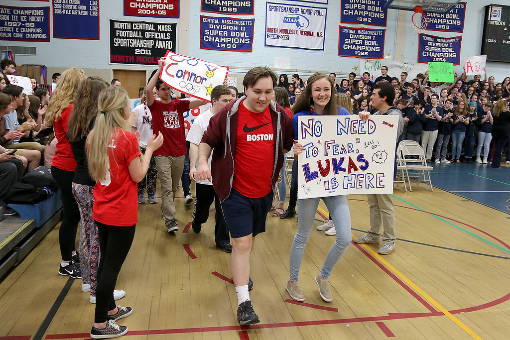 . North Middlesex Regional High School members of Best Buddies, the Unified Track team and athletes participating in Friday\'s Special Olympics at Fitchburg State University  parade into the gym at the school during the Pep Rally on Thursday. SENTINEL & ENTERPRISE/JOHN LOVE