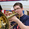 North Middlesex Regional High School junior Alexander Nick plays the mellophone with the band during the schools Pep Rally for the students taking part in Friday's Special Olympics at Fitchburg State University. SENTINEL & ENTERPRISE/JOHN LOVE