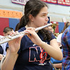 North Middlesex Regional High School senior Tess Gagnon plays the flute with the band during the schools Pep Rally for the students taking part in Friday's Special Olympics at Fitchburg State University. SENTINEL & ENTERPRISE/JOHN LOVE