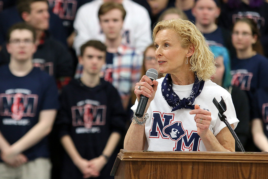 . North Middlesex Regional High School Special Olympics and Unified Track coach Julie McIntyre addresses the crowd at the 10th annual pep rally for the schools athletes that will be participating in Friday\'s Special Olympics at Fitchburg State University. SENTINEL & ENTERPRISE/JOHN LOVE