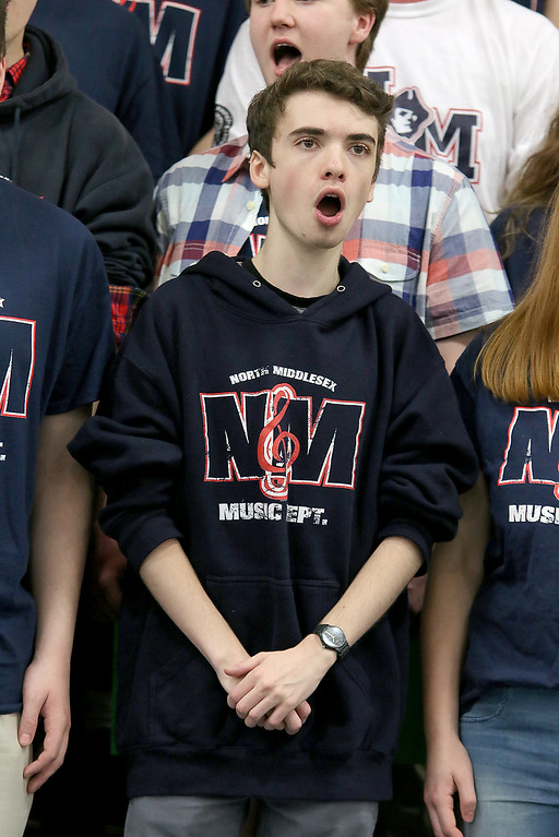 . North Middlesex Regional High School senior Noah Meunier sings the schools song with the chorus at the 10th annual pep rally for the schools athletes that will be participating in Friday\'s Special Olympics at Fitchburg State University. SENTINEL & ENTERPRISE/JOHN LOVE