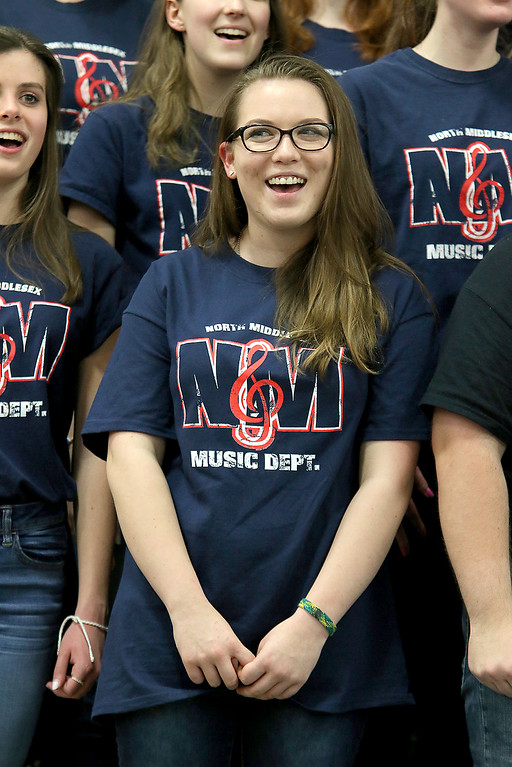 . North Middlesex Regional High School junior Hannah Keese sings the schools song with the chorus at the 10th annual pep rally for the schools athletes that will be participating in Friday\'s Special Olympics at Fitchburg State University. SENTINEL & ENTERPRISE/JOHN LOVE