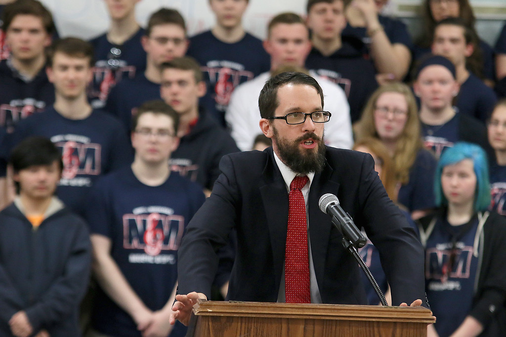 . North Middlesex Regional High School Principal Isaac Taylor addresses the crowd at the 10th annual pep rally for the schools athletes that will be participating in Friday\'s Special Olympics at Fitchburg State University. SENTINEL & ENTERPRISE/JOHN LOVE