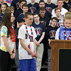 North Middlesex Regional High School seniors, from left, Sarah Stadeler, Alec Guth and Clancy Ronan, at microphone, tell the history of the Special Olympics at the 10th annual pep rally for the schools athletes that will be participating in Friday's Special Olympics at Fitchburg State University. SENTINEL & ENTERPRISE/JOHN LOVE