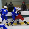 Leominster High School hockey player North Middlesex Regional High School on Saturday afternoon at the the Wallace Civic Center at Fitchburg State University. LHS's Alex Helenius and NMRHS's Colin Massida fight for control of the puck as LHS's Adam DeAmicis waits to see if it pops free. SENTINEL & ENTERPRISE/JOHN LOVE