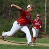 North Middlesex Regional High School baseball had a home game against Oakmont Regional High School on Wednesday afternoon. NMRHS pitcher Brenden Sullivan winds up to deliver a pitch during the game. SENTINEL & ENTERPRISE/JOHN LOVE