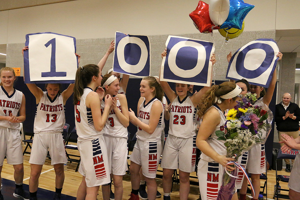 . North Middlesex Regional High School player Hadley Beauregard had already reached 1000 points but after her first basket, in front of her home crowd, she was honored for making that mile stone. her team hold up 1000 for her on the sidelines after her basket. SENTINEL & ENTERPRISE/JOHN LOVE
