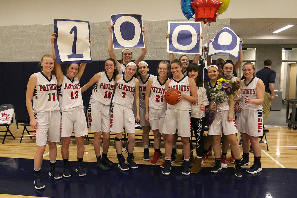 . North Middlesex Regional High School player Hadley Beauregard had already reached 1000 points but after her first basket, in front of her home crowd, she was honored for making that mile stone. her team hold up 1000 for her on the sidelines after her basket. Beauregard, center with ball, poses with her team. SENTINEL & ENTERPRISE/JOHN LOVE