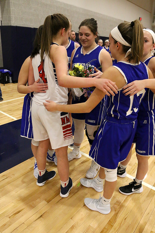 . Lunenburg girls team honored North Middlesex Regional High School\'s Hadley Beauregard at Friday nights game after she made her first bakset. She reached the milestone of 1000 points. SENTINEL & ENTERPRISE/JOHN LOVE