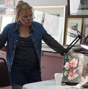 Sahyly Martinez studying Carol's floral painting