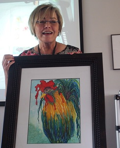 Nancy Diaz with a finished and framed example of her artwork.