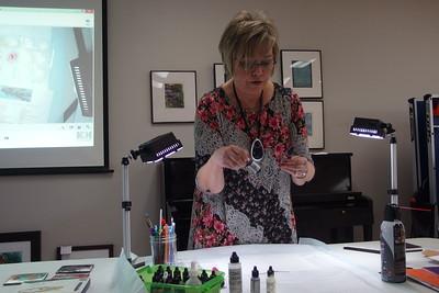 Nancy Diaz explaining the inks.