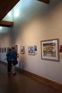 Joy Calvert  & Johnnie Gubanski admiring the winning paintings.