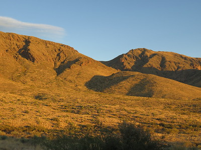 Early glow of sunset on the Organ Mountains