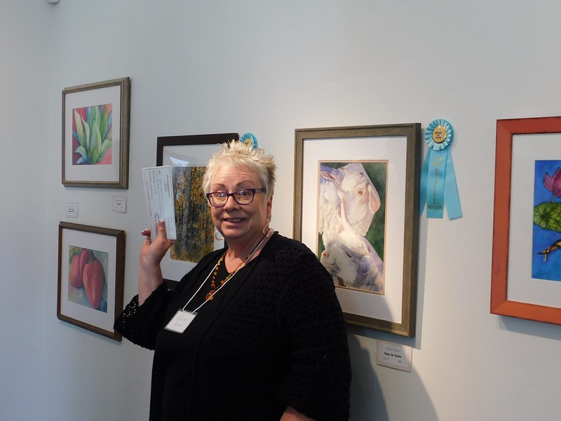Laurel Weathersbee, our tireless Exhibition Chairperson, handing out awards.