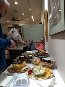 Goodie table - Paul Vakselis talking to Johnnie and Joy.