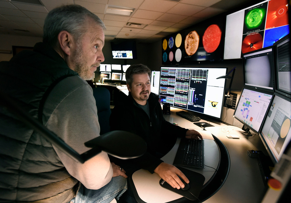 . National Oceanic and Atmospheric Administration Space Weather Forecasters Ken Tegnell, left, and Jeff Stankiewicz work together to monitor the sun at the Space Weather Prediction Center on Friday on the NOAA campus in Boulder. For more photos of the space weather forecasters at work go to www.dailycamera.com Jeremy Papasso/ Staff Photographer/ Jan. 13, 2017
