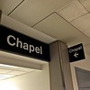 I would sleep overnight in the airport.  Actually I would sleep overnight in the airport chapel.