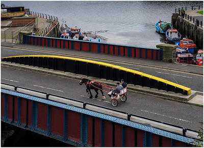 TROTTING ACROSS THE OUSEBURN QUAYSIDE BRIDGE