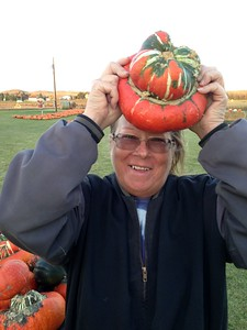 Shelly with a turks turban squash @ Berry Acres Pumpkin patch and corn maze near Minot, ND