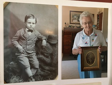 Elizabeth Robinson Hill holding a photo of her father, George Robinson, when he was very young