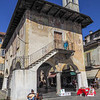 A street musician plays at the site of the old market in Orta.