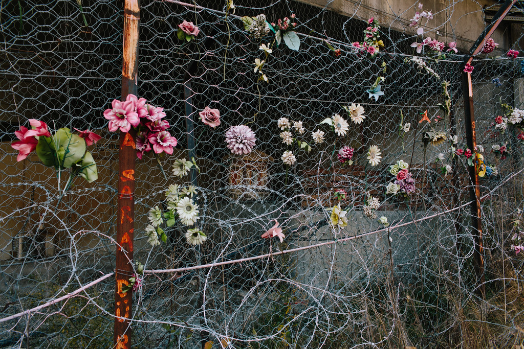 While securing the are the security forces removed the holy, 4-sided shrine from its initial location. It was moved behind the fence and is now stored behind military ablutions. Since than local congregations leave flowers on the fence.