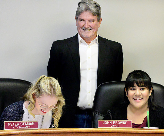 KEVIN HARVISON | Staff photo Pictured from left, Gabbie Williams, McAlester Mayor John Browne and Mikayla Walker enjoy a laugh during a mock city council meeting for McAlester High School Student Government Day Thursday inside the city council chambers.