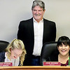 KEVIN HARVISON | Staff photo<br /> Pictured from left, Gabbie Williams, McAlester Mayor John Browne and Mikayla Walker enjoy a laugh during a mock city council meeting for McAlester High School Student Government Day Thursday inside the city council chambers.