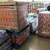 KEVIN HARVISON | Staff photo<br /> Gene Walker, Scott Walkers nephew, brings in another pallet of food for Shared Blessings.