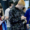KEVIN HARVISON | Staff photo<br /> Students get information about the University of Arkansas Fort Smith while they participated in a career fair Wednesday at the Southeast Expo building.