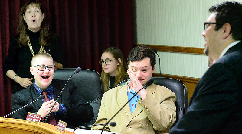 KEVIN HARVISON | Staff photo Pictured far right, McAlester High School Vic Principal Dewayne Hampton, gets a reaction during the McAlester High School Student Government Day Mock City Council Meeting Thursday inside the council chambers.